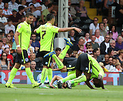 Sam Baldock and Kazenga LuaLua celebrating scoring by doing a forward role during the Sky Bet Championship match between Fulham and Brighton and Hove Albion at Craven Cottage, London, England on 15 August 2015. Photo by Matthew Redman.