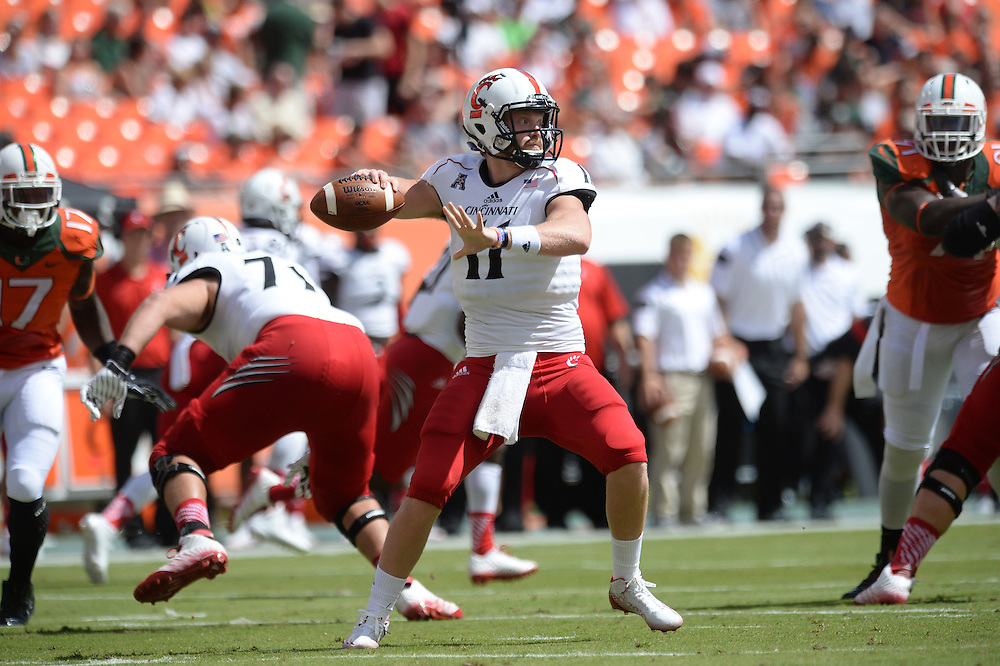 October 11, 2014: Gunner Kiel #11 of the Cincinnati Bearcats drops back to pass during the football game between the Cincinnati Bearcats and the Miami Hurricanes at Sun Life Stadium in Miami Gardens, FL. The Hurricanes defeated the Bearcats 55-34.