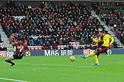 Andre Gray (18) of Watford shoots at goal during the Premier League match between Bournemouth and Watford at the Vitality Stadium, Bournemouth, England on 12 January 2020.