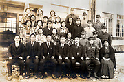 Japan school group photo with male students in military uniform ca 1930s