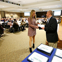 Thomas Wells | Buy at PHOTOS.DJOURNAL.COM<br /> Maggie Smithey of Ignomar High School picks up her top player for Class 2A Slow-Pitch Softabll from Northeast Mississippi Daily Journal General Manager Danny Smith at the 2016 Fall Sports Banquet on Thursday.