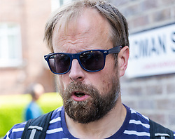 Serving Met Police Constable Oliver Darcy leaves Blackfriars Crown Court in London following his sentencing for theft of a driving licence and bank card in the name of the deceased male whose body he was supposed to be guarding. London, August 27 2019.