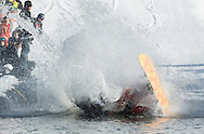 A snowboarder crashes into the water during the Wacky Water Event at the Spring  Rally at Mount Peter Ski and Ride in Warwick, New York. The Spring Rally traditionally closes the season at the ski area.