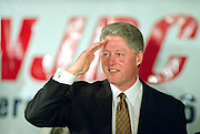 US President Bill Clinton salutes after addressing the National Jewish Democratic Council November 2, 1995 in Washington, DC.