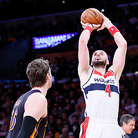 21 March 2014: Washington Wizards center Marcin Gortat (4) takes a jump shot during the Washington Wizards 117-107 victory over the Los Angeles Lakers at the Staples Center, Los Angeles, California, USA.