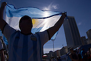 An Argentina fan with a flag is silhouetted with a flag at the FIFA Fan Fest, Copacabana beach, Rio de Janeiro, during the Argentina v Belgium World Cup quarter final match which was shown on big screens.<br /> Picture by Andrew Tobin/Focus Images Ltd +44 7710 761829<br /> 05/07/2014