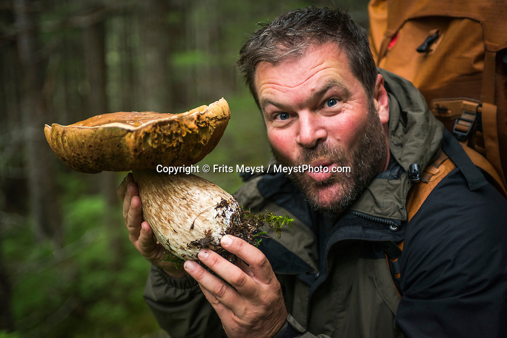 Alaska, USA to Yukon Territory, Canada, September 2014. Everything is bigger in Alaska, even this monster mushroom. Hiking from Finnigan's Point to Sheep Camp through thick Pacific rainforest. Starting at Dyea, Alaska, The Chilkoot Trail retraces the Klondike Gold Rush route that most stampeders followed to get to the gold fields. Steeped in Klondike Gold Rush history and scattered with relics from the past, the famous Chilkoot Trail is also referred to as the longest open air museum in the world. This rugged 55 kilometer wilderness trek is a world-renowned hiking trail and Canada's largest National Historic Site. Photo by Frits Meyst / MeystPhoto.com
