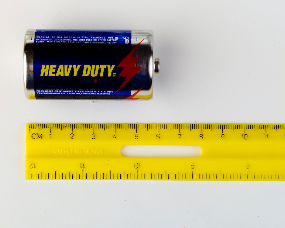 A ruler, a kind of measurement tool, can be used to measure the size of toys, crayons, beans and more.