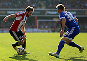 Alan Judge taking on Ben Osborn during the Sky Bet Championship match between Brentford and Nottingham Forest at Griffin Park, London, England on 6 April 2015. Photo by Matthew Redman.