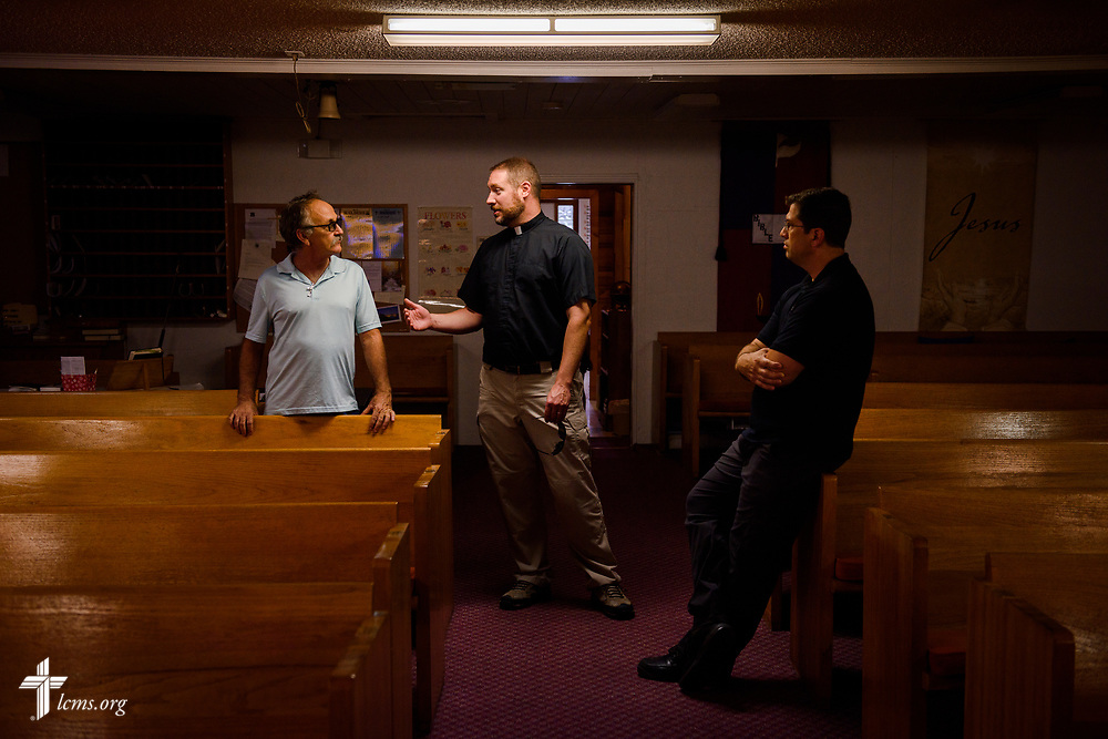 The Rev. Michael Meyer (center), manager for LCMS Disaster Response, and the Rev. Dr. Ross Johnson, director of LCMS Disaster Response, talk with the Rev. Anthony Arias, pastor of Grace Lutheran Church, Arcadia, Fla., at the church on Thursday, Sept. 14, 2017. The church weathered Hurricane Irma as it passed through the state. LCMS Communications/Erik M. Lunsford