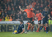30th August 2019; Dens Park, Dundee, Scotland; Scottish Championship, Dundee Football Club versus Dundee United; Josh Meekings of Dundee tackles Lawrence Shankland of Dundee United