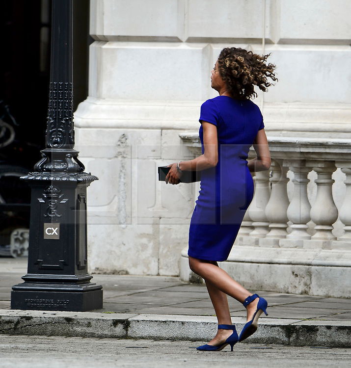 "© Licensed to London News Pictures. 30/05/2015. London, UK. Naomie Harris pictured in  blue dress. Filming for the new James Bond film ""Spector"" with Daniel Craig and Naomie Harris at the courtyard of the UK Government Treasury building in Westminster, London . Photo credit: Ben Cawthra/LNP"