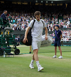 LONDON, ENGLAND - Friday, July 1, 2011: Andy Murray (GBR) dejectedly walks off Centre Court after losing the Gentlemen's Singles Semi-Final match on day eleven of the Wimbledon Lawn Tennis Championships at the All England Lawn Tennis and Croquet Club. (Pic by David Rawcliffe/Propaganda)