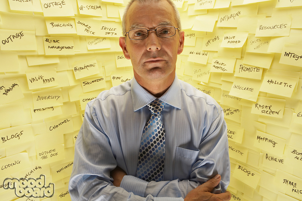 Businessman Standing at Wall with Post Its