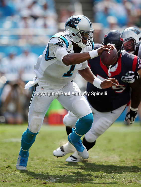 Carolina Panthers quarterback Cam Newton (1) is flushed out of the pocket by Houston Texans nose tackle Vince Wilfork (75) during the 2015 NFL week 2 regular season football game against the Houston Texans on Sunday, Sept. 20, 2015 in Charlotte, N.C. The Panthers won the game 24-17. (©Paul Anthony Spinelli)