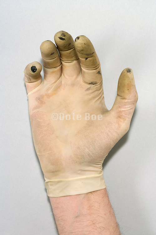 hand with dirty latex glove