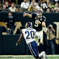 Nov 27, 2016; New Orleans, LA, USA;  New Orleans Saints quarterback Drew Brees (9) throws as Los Angeles Rams cornerback Lamarcus Joyner (20) pressures during the first half of a game at the Mercedes-Benz Superdome. Mandatory Credit: Derick E. Hingle-USA TODAY Sports