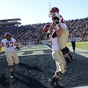 Paul Stanton, Harvard, (twenty-nine), is lifted by  by team mate Michael Mancinelli,  after scoring one of his four touchdowns during the Yale V Harvard, Ivy League Football match at Yale Bowl. Harvard won the game 34-7 giving Harvard a share of the 2013 Ivy League title.  The game was the 130th meeting between Harvard and Yale in the historic rivalry that dates back to 1875. New Haven, Connecticut, USA. 23rd November 2013. Photo Tim Clayton