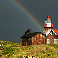 After a storm, a rainbow arcs over Cape Horn Lighthouse and Stella Maris Chapel on Cape Horn in Chile. Cape Horn (Cabo de Hornos) is the southernmost headland of the Tierra del Fuego archipelago and it marks the northern boundary of the Drake Passage and where the Atlantic and Pacific Oceans meet.