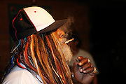 Nice, France. July 22nd 2006..George Clinton smokes a joint at the bar of the Hotel Radisson after his concert at the Nice Jazz Festival.