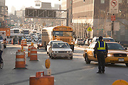 police checking automobile traffic going on to the Manhattan Bridge