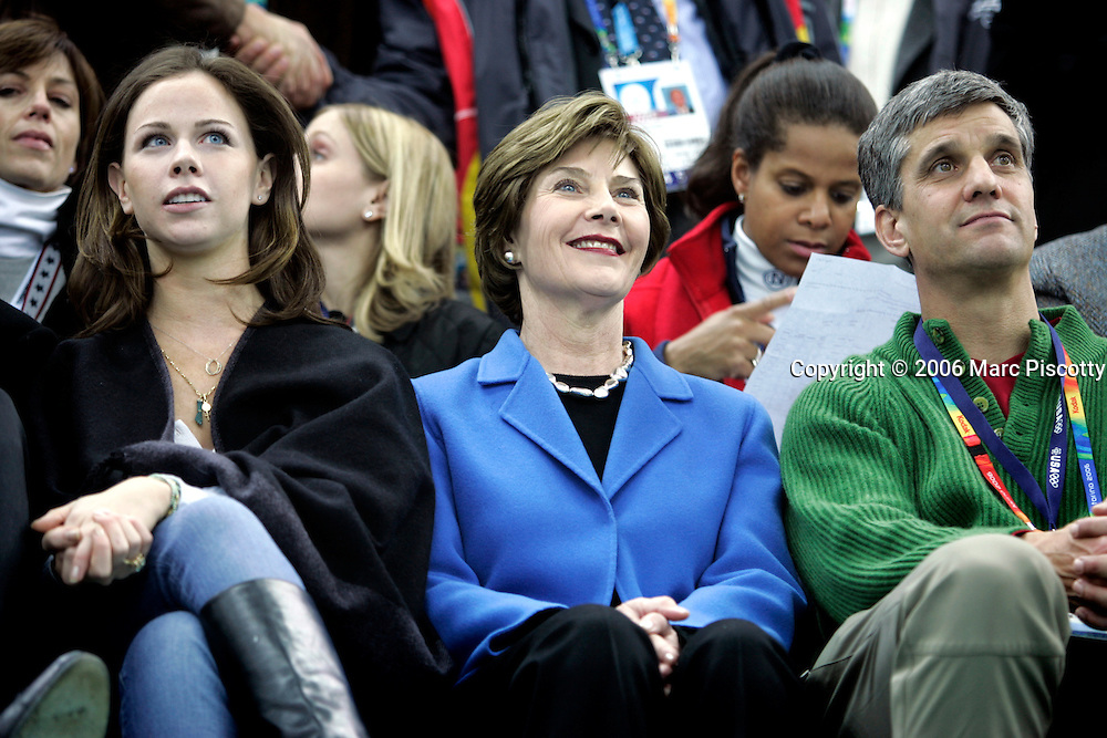 First Lady Laura Bush (center) took in the Men's 5000 Meter Long Track Speed Skating event at the Oval Lingotto in Turin, Italy Saturday February 11, 2006. She was on hand to watch as American speed skater Chad Hedrick won the gold medal with a time of 6:14.68 while teammate Shani Davis finished seventh, 8.14 seconds behind Hedrick. Holland's Sven Kramer won the silver medal and Italy's Enrico Fabris won the bronze..(Photo by Marc Piscotty / © 2006)