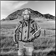 "Joseph Flying By (1917-2000), a Lakota medicine man, at Bear Butte, SD. His Lakota name is Kangi Ho Tanka, which means ""Crow with a Loud Voice."""