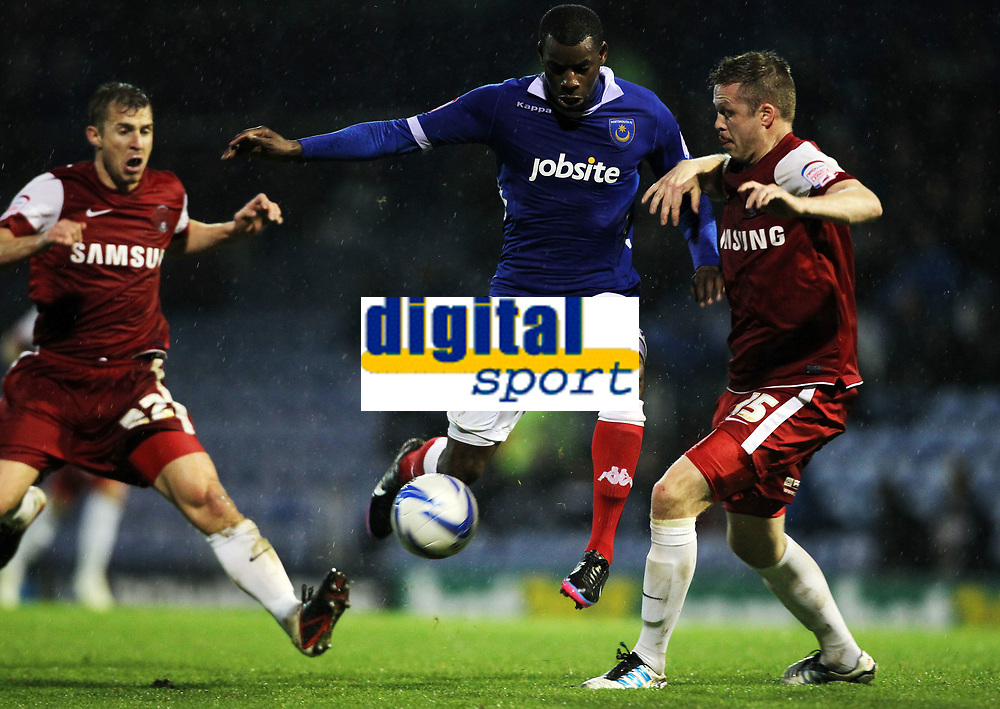 npower League One - 20/11/2012 - Portsmouth vs Leyton Orient at Fratton Park<br /> Portsmouth's Izale McLeod battles with Leyton Orient's Nathan Clarke
