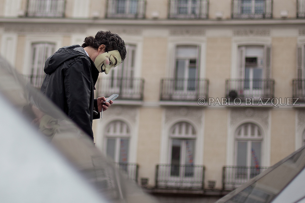 Spain's 'indignant' protester marches at Puerta del Sol Square wearing a 'anonymous o v for vendetta' mask on November 13, 2011in Madrid, Spain, to protest against spending cuts, high unemployment and political corruption, a week before a general election. Spain's so-called 'indignant' protest movement was born when thousands of people set up camp in Madrid's Puerta del Sol square ahead of May 22 municipal elections. (PABLO BLAZQUEZ)