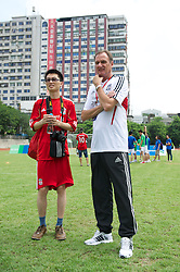GUANGZHOU, CHINA - Wednesday, July 13, 2011: Liverpool ambassador Phil Thompson during a coaching clinic for local youngsters at the Guangzhou Sports University during day three of the club's Asia Tour. (Photo by David Rawcliffe/Propaganda)