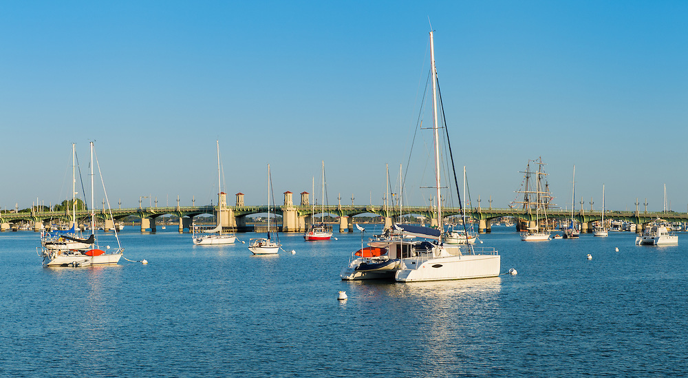 Anchored boats in the Matanzas river in St. Augustine, Florira. View of the Bridge of Lions in the background