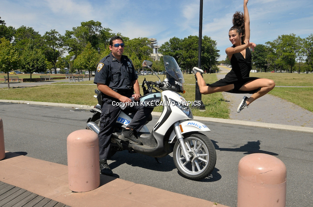MR - Model released picture of a italian descent actress and dancer in Flushing Meadow Park in Queens., Note: Model is released, policeman is NOT