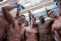 © licensed to London News Pictures. London, UK 12/05/2012. 100 Lifeguards throwing and handing out underwears as they promote opening of the new Gilly Hicks and Hollister Flagship Stores on Regent Street, this morning (12/05/12). Photo credit: Tolga Akmen/LNP