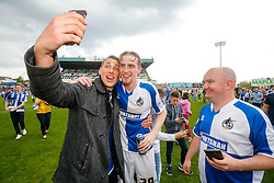 Oliver McBurnie of Bristol Rovers has a selfie with a fan after Bristol Rovers win the match in injury time to secure 3rd place in League 2, back to back promotions and a place in Sky Bet League 1 for 2016/17 - Mandatory byline: Rogan Thomson/JMP - 08/03/2016 - FOOTBALL - Memorial Stadium - Bristol, England - Bristol Rovers v Dagenham & Redbridge - Sky Bet League 2.