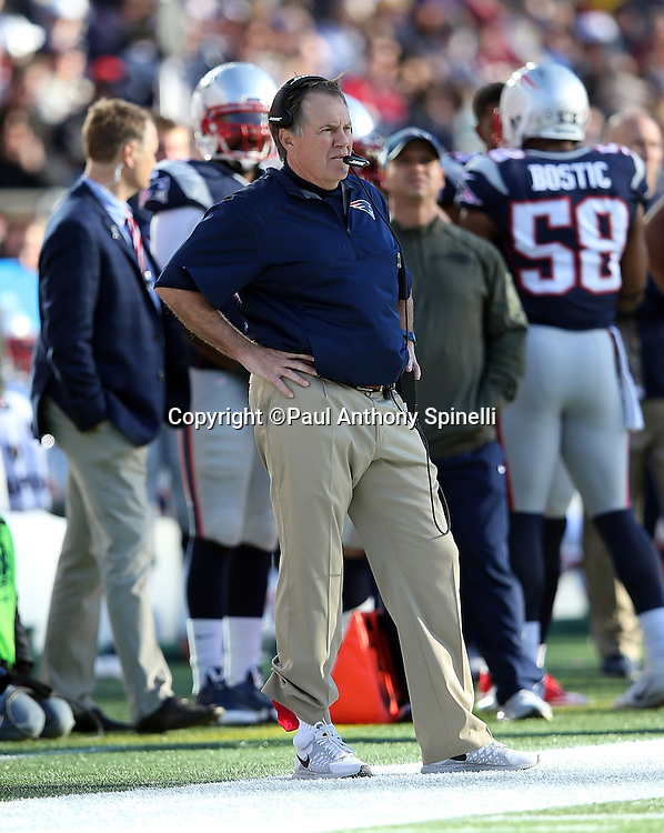 New England Patriots head coach Bill Belichick looks on from the sideline during the 2015 week 9 regular season NFL football game against the Washington Redskins on Sunday, Nov. 8, 2015 in Foxborough, Mass. The Patriots won the game 27-10. (©Paul Anthony Spinelli)