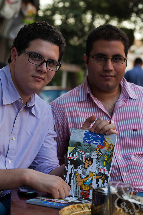 """Division Publishing co-founders Marwan Imam (l) and Mohamed Reda pose for a portrait August 30, 2011 in Cairo, Egypt. The two 24 year old Cairo residents have launched a bimonthly graphic novel series called """"Autostrade"""" and hope their Division Publishing company will become a launching pad for other graphic novels. (Photo by Scott Nelson for the National)"""