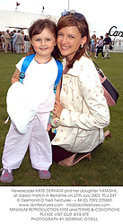 Newsreader KATIE DERHAM and her daughter NATASHA, at a polo match in Berkshire on 27th July 2003.PLU 247