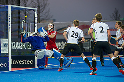 Great Britain's George Pinner can't prevent the shot from Mats Grambusch going over the line to equalise for Germany. Great Britain v Germany, Lee Valley Hockey & Tennis Centre, London, UK on 14 April 2015. Photo: Simon Parker