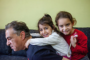 "Father Eduard Polanski (47) is playing with his daughters Sara (6) on the right and Kristina (4) in their temporary home in Ostrava. Sara's mother was advised from one of the schools that she should not enrol her daughter there - after the girl passed the enrolment test - because Sara is so ""slim"". Mother Ingrid Kandracova (36) new that the final decision is on her side and she refused the advice and enrolled her daughter in the school."