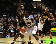 "Ole Miss' Murphy Holloway (31) drives as Grambling State's Steven dandridge (42) and Rondale Divas (2) defend during the first half at the C.M. ""Tad"" Smith Coliseum in Oxford, Miss. on Monday, November 14, 2011.."