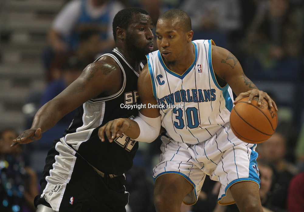 Mar 01, 2010; New Orleans, LA, USA; New Orleans Hornets forward David West (30) drives in against San Antonio Spurs forward DeJuan Blair (45) during the first half at the New Orleans Arena. Mandatory Credit: Derick E. Hingle-US PRESSWIRE