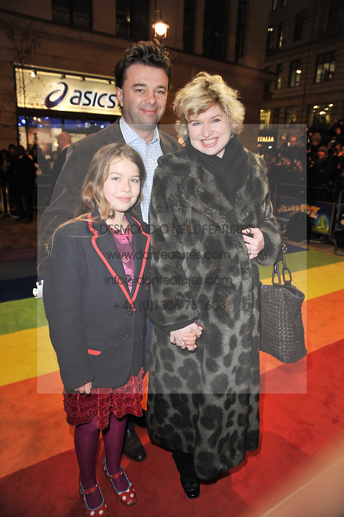 EDWARD HALL, IZZY VAN RANDWYCK and their daughter GEORGIA HALL arrive at the press night of the new Andrew Lloyd Webber  musical 'The Wizard of Oz' at The London Palladium, Argylle Street, London on 1st March 2011 followed by an aftershow party at One Marylebone, London NW1