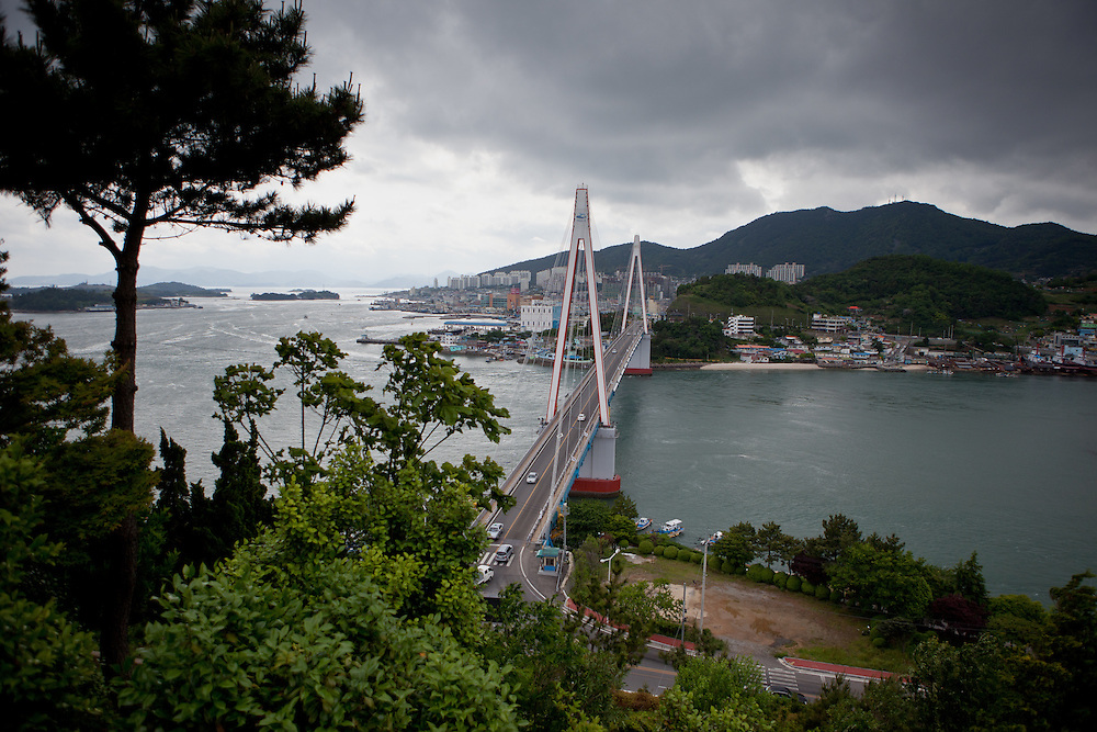 "Dolsan Bridge - a 450-meter cable stayed bridge - in the city of Yeosu. Yeosu will host the Expo 2012 exhibition under the theme ""The Living Ocean and Coast"". Yeosu (Yeosu-si) is a city in South Jeolla Province. Old Yeosu City, which was founded in 1949, Yeocheon City, founded in 1986, and Yeocheon County were merged into a new city in 1998."