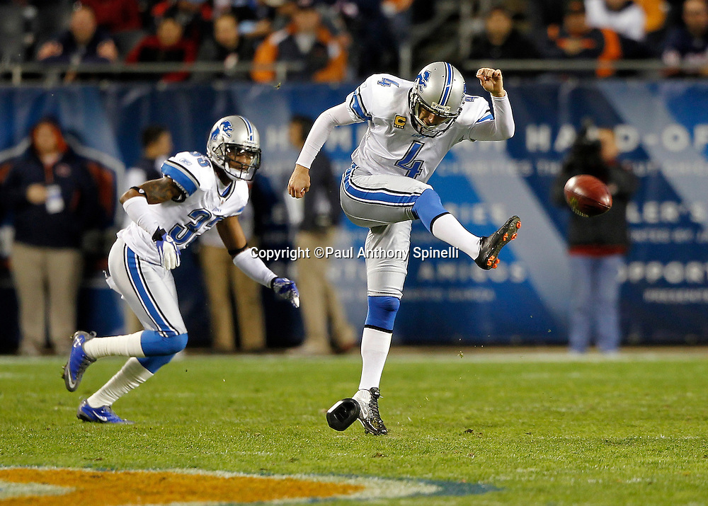 Detroit Lions kicker Jason Hanson (4) attempts an onside kick during the NFL week 10 football game against the Chicago Bears on Sunday, November 13, 2011 in Chicago, Illinois. The Bears won the game 37-13. ©Paul Anthony Spinelli