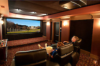 Relax into this awesomely comfy screen room, complete with projection tv system and reclining leather chairs.