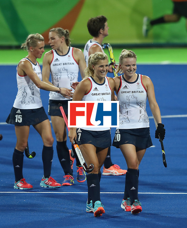 RIO DE JANEIRO, BRAZIL - AUGUST 15:  Georgie Twigg (L) and Hollie Webb of Great Britain celebrate after their victory during the Women's quarter final hockey match between Great Britain and Spain on Day10 of the Rio 2016 Olympic Games held at the Olympic Hockey Centre on August 15, 2016 in Rio de Janeiro, Brazil.  (Photo by David Rogers/Getty Images)