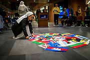 Community members participate in the annual Flag Ceremony in the Hemmingson Center. (GU photo by Gavin Doremus)