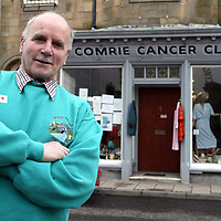 David Robertson...10.5.2002.  Attn: Daily Mail Pix.<br />Comrie's Mr Charity, Dave Robertson at the Comrie Cancer Club shop in the centre of the Perthshire village.<br /><br />Picture by John Lindsay .<br />COPYRIGHT: Perthshire Picture Agency.<br />Tel. 01738 623350 / 07775 852112.
