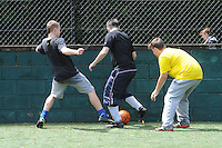 Football between locals and the police at Breaks Manor on the Olympic Torch Relay passes through Hatfield, Herts,