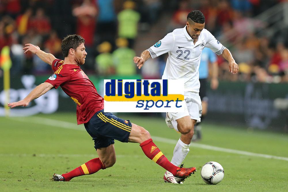 FOOTBALL - UEFA EURO 2012 - DONETSK - UKRAINE  - 1/4 FINAL - SPAIN v FRANCE - 23/06/2012 - PHOTO PHILIPPE LAURENSON /  DPPI - GAEL CLICHY (FRA) / XABI ALONSO (ESP)